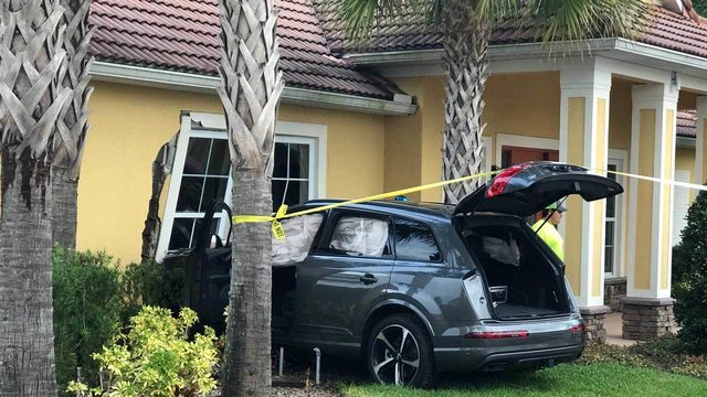 Car slams into clubhouse building in Sanford