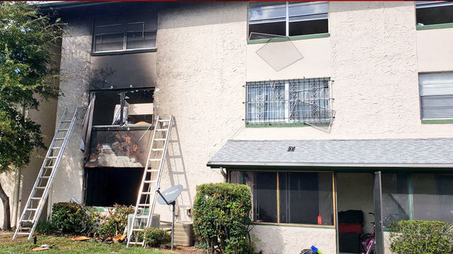 Orange County firefighters rescue couple from apartment fire