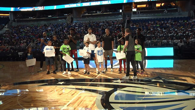 Orlando Magic players celebrate most-improved readers on the court