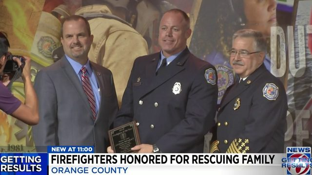 Orange County firefighters receive medals for rescuing family
